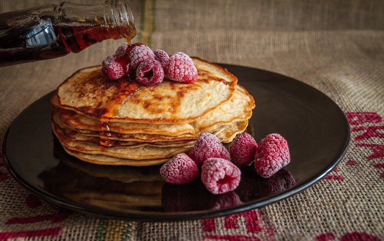 pancakes, maple syrup, raspberries
